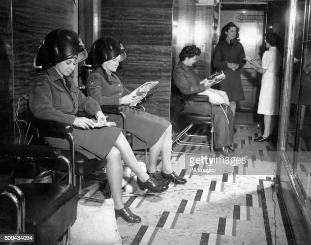 Although the 'Queen Elizabeth' as a transport is like a floating garrison the beauty parlours and women's hairdressing saloon are still in action for...