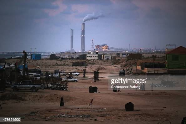 Although there are constant power cuts in Gaza Palestinians can see the Ashkelon power station across the border in Israel from Gaza Beach on June 10...
