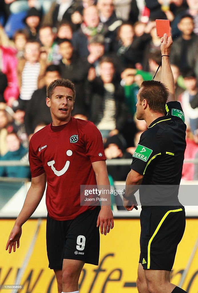 <a gi-track='captionPersonalityLinkClicked' href=/galleries/search?phrase=Altin+Lala&family=editorial&specificpeople=634707 ng-click='$event.stopPropagation()'>Altin Lala</a> ( L) of Hanover gets the red card from referee <a gi-track='captionPersonalityLinkClicked' href=/galleries/search?phrase=Peter+Gagelmann&family=editorial&specificpeople=808542 ng-click='$event.stopPropagation()'>Peter Gagelmann</a> during the Bundesliga match between Hanover 96 and Borussia Dortmund at AWD Arena on September 18, 2011 in Hannover, Germany.