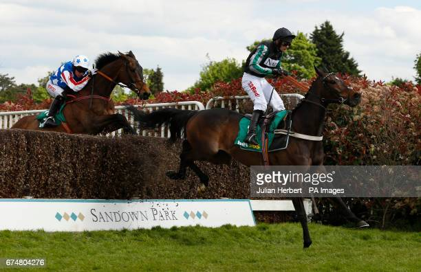 Altior ridden by Nico de Boinville leads Special Tiara ridden by Noel Fehily over the last fence before going on to win The bet365 Celebration...