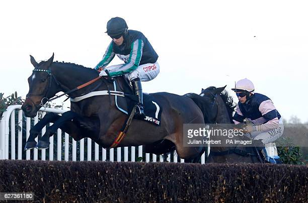 Altior ridden by Noel Fehily clears an early fence before going on to win The Racing Post Henry VIII Novices' Steeple Chase Race run during day two...