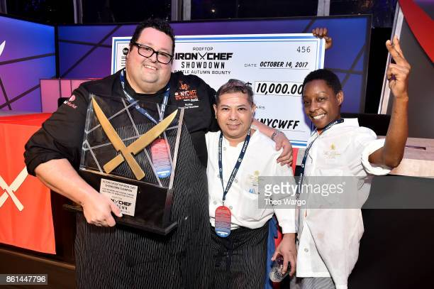 Alton's Rooftop Iron Chef Showdown Champion winner Chef Michael Mignano of Perrine poses with his team at the Food Network Cooking Channel New York...