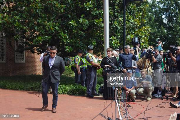 Altright blogger Jason Kessler waits for protesters to quiet before begnning a news conference in front of City Hall August 13 2017 in...
