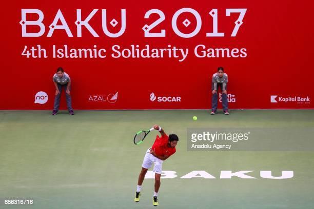 Altug Celikbilek of Turkey returns the ball to Amine Ahouda of Morocco during the Baku 2017 4th Islamic Solidarity Games Men's Semi final tennis...