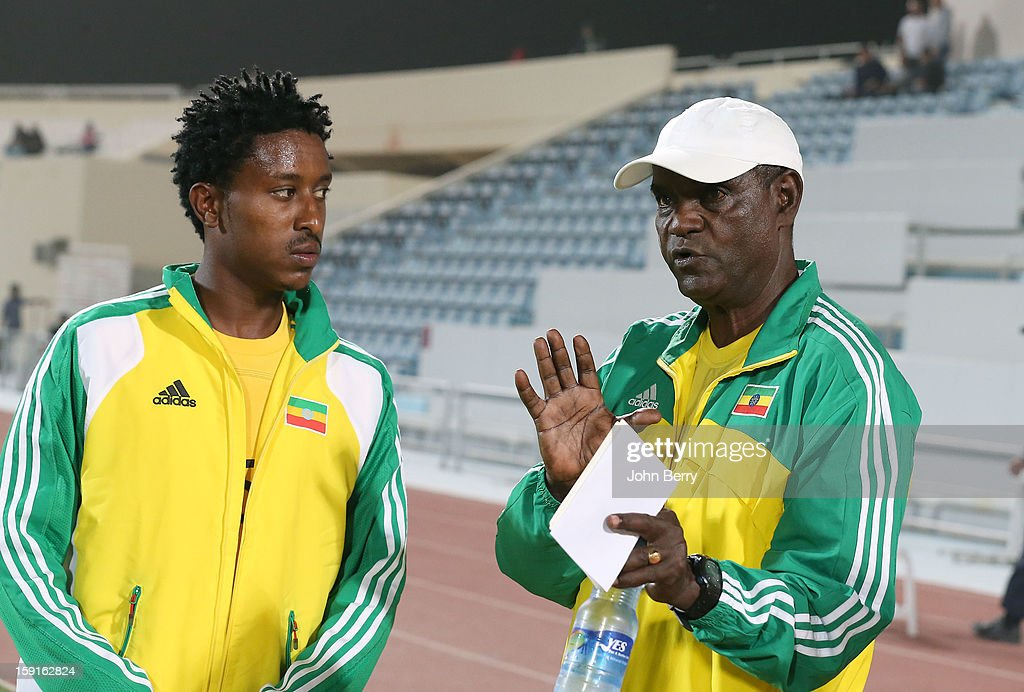 Alula Girma of Ethiopia listens to Sewnet Bishaw, coach of Ethiopia before the international friendly game between Tunisia and Ethiopia at the Al Wakrah Stadium on January 7, 2013 in Doha, Qatar.