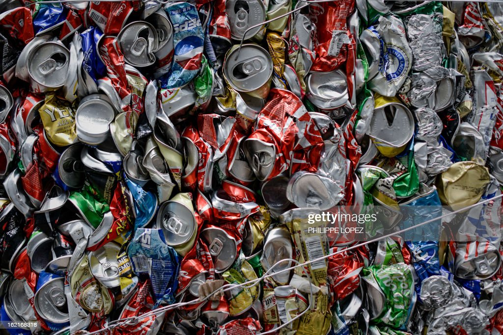 Aluminium cans are seen compressed before recycling in Hong Kong on February 20, 2013. Activists have claimed for years that Hong Kong lags behind the rest of the world on environmental issues ranging from recycling to lanes for cyclists. AFP PHOTO / Philippe Lopez