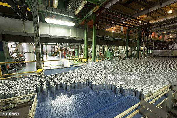 Aluminium cans being made in an industrial factory