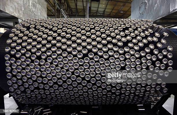Aluminium cans pass through a washing machine as they travel along the production line at Rexam Plc's beverage can plant in Wakefield UK on Tuesday...
