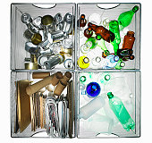 Aluminium, glass, paper and cardboard materials organized for recycling