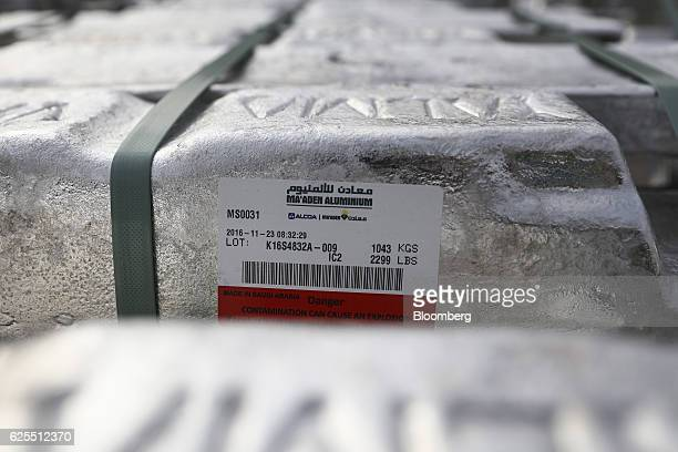 Aluminium ingots bearing the Ma'aden and Alcoa Inc names sit outside the aluminium processing area at the Ras Al Khair Industrial City operated by...