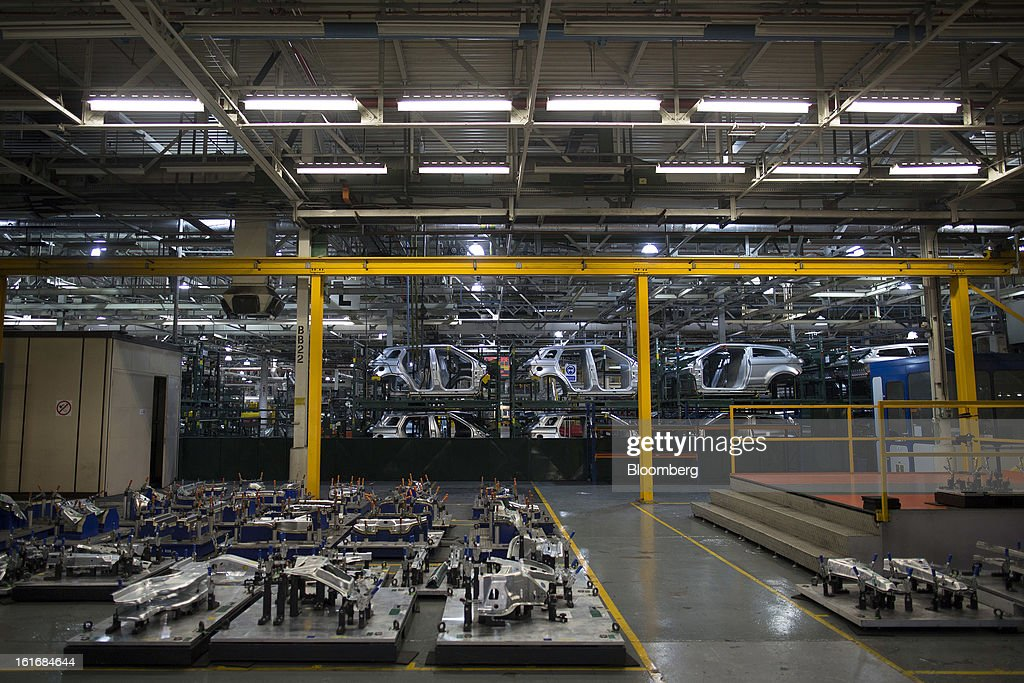 Aluminum body panels for Range Rover Evoque SUV automobiles, produced by Jaguar Land Rover Plc, a unit of Tata Motors Ltd., travel along the production line at the company's assembly plant in Halewood, U.K., on Wednesday, Feb. 13, 2013. Carmakers from Ford Motor Co. to Audi AG and Jaguar Land Rover Plc are using record amounts of aluminium to replace heavier steel, providing relief to producers of the metal confronting excess supplies and depressed prices. Photographer: Simon Dawson/Bloomberg via Getty Images