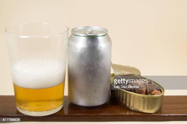 aluminum can calamari, beer Can and glass of beer