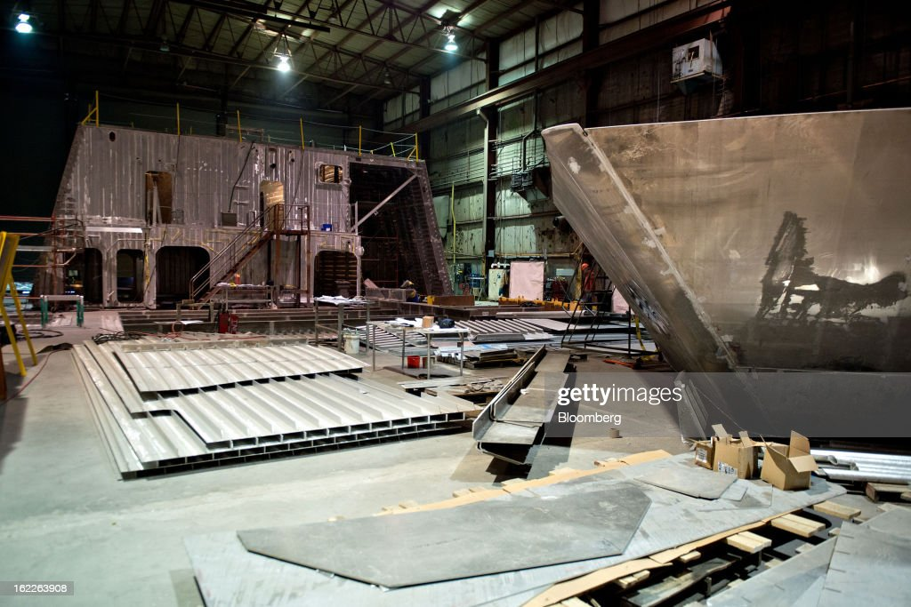 Aluminum sections of a U.S. Navy Littoral Combat Ship (LCS) sit on the production floor at Marinette Marine Corp., in Marinette, Wisconsin, U.S., on Monday, Feb. 11, 2013. Marinette Marine Corp. makes one version of the Littoral Combat Ship in partnership with Lockheed Martin Corp. As the Pentagon faces $500 billion in spending cuts over a decade that are set to begin March 1, the $37 billion program to design and build Littoral Combat Ships may become a target for reductions that would take business from Lockheed and Austal Ltd., which also makes a version of the ship in partnership with General Dynamics Corp. at Austal's yard in Mobile, Alabama. Photographer: Daniel Acker/Bloomberg via Getty Images