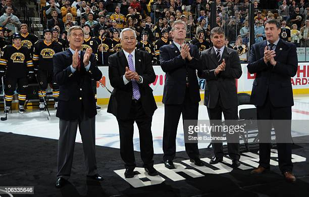 Alumni Bobby Orr John Bucyk Terry O'Reilly Ray Bourque and Cam Neely of the Boston Bruins watch Milt Schmidt raise his banner to the rafters before...