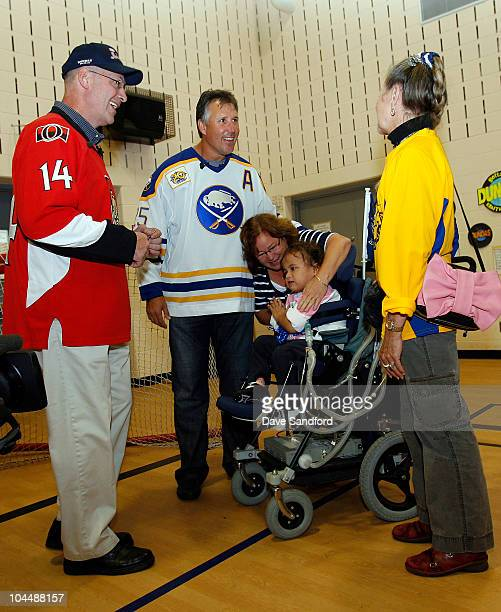 Alumni Brad Marsh and Dave Andreychuk meet and speak to a student at St Augustine's elementary school during the NHL Kraft Hockeyville 2010 on...