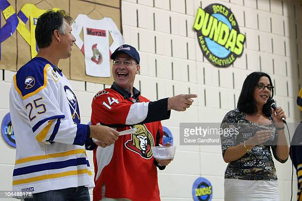 Alumni Brad Marsh and Dave Andreychuk share a laugh while speaking at St Augustine's elementary school during the NHL Kraft Hockeyville 2010 on...