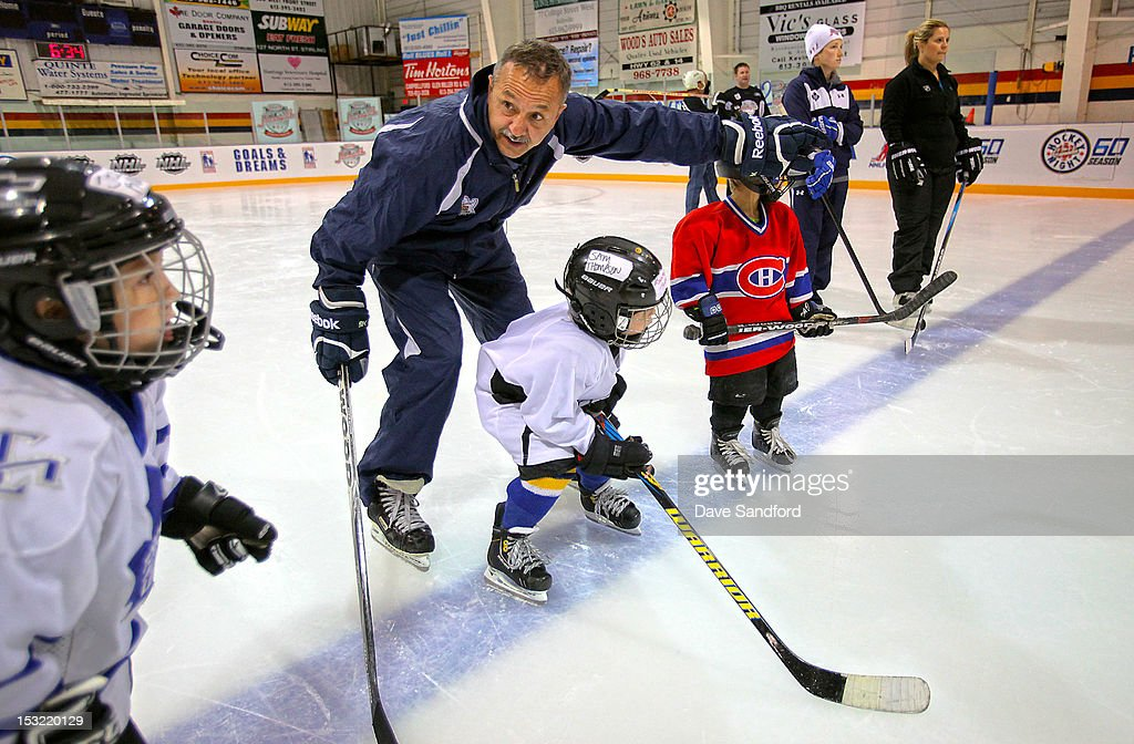 Alumni Dan Daoust teaches kids in a hockey clinic held at the Stirling and District Recreation Centre during Kraft Hockeyville Day 2 on October 1, 2012 in Stirling, Ontario, Canada.