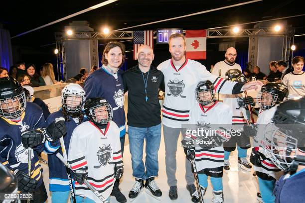 NHL Alumni Daniel Carcillo Brad Erickson and NHL Alumni Brian Bickell attend Sheraton Hotels Resorts Host 'Go Beyond' Challenge With NHL Alumni For...