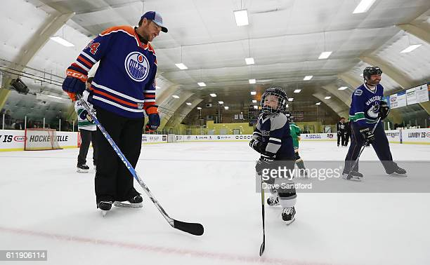 Alumni Fernando Pisani gives instruction to a youth hockey player in the on ice clinic at the Pat Duke Memorial Arena during Day 2 of NHL Kraft...