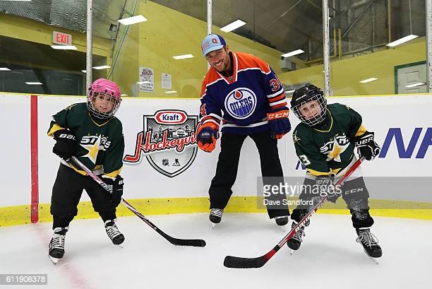 Alumni Fernando Pisani poses with two youth hockey players in the on ice clinic at the Pat Duke Memorial Arena during Day 2 of NHL Kraft Hockeyville...