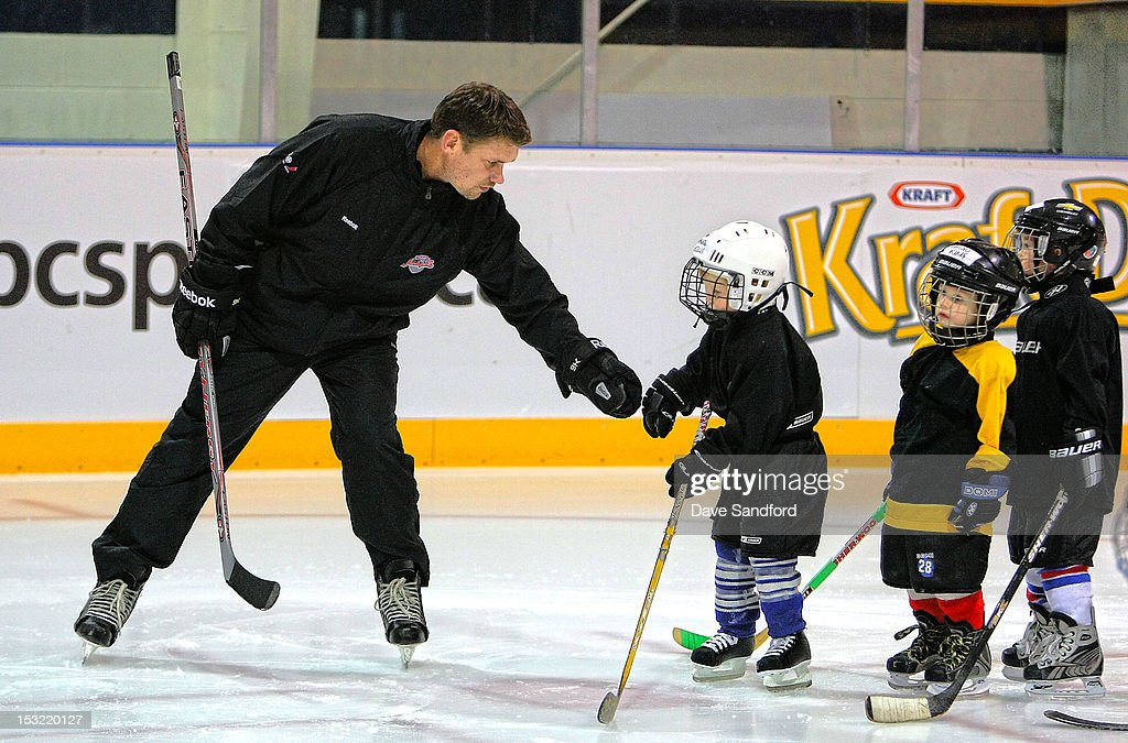 Alumni <a gi-track='captionPersonalityLinkClicked' href=/galleries/search?phrase=Jamie+Allison&family=editorial&specificpeople=243002 ng-click='$event.stopPropagation()'>Jamie Allison</a> teaches kids in a hockey clinic held at the Stirling and District Recreation Centre during Kraft Hockeyville Day 2 on October 1, 2012 in Stirling, Ontario, Canada.