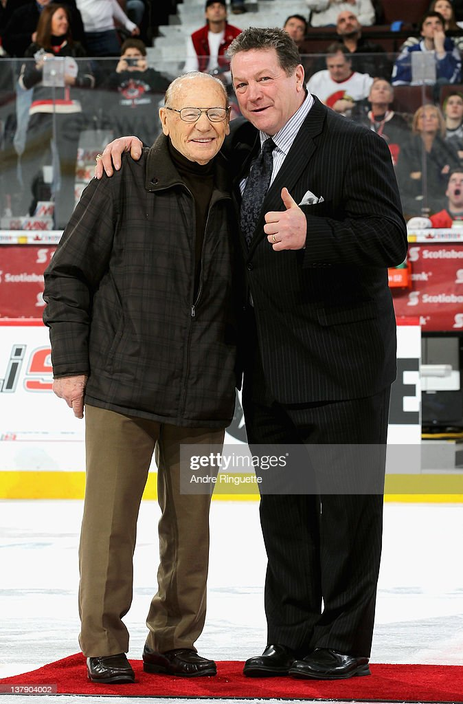 Alumni <a gi-track='captionPersonalityLinkClicked' href=/galleries/search?phrase=Johnny+Bower&family=editorial&specificpeople=239053 ng-click='$event.stopPropagation()'>Johnny Bower</a> and <a gi-track='captionPersonalityLinkClicked' href=/galleries/search?phrase=Denis+Potvin&family=editorial&specificpeople=598499 ng-click='$event.stopPropagation()'>Denis Potvin</a> pose on the ice during the first intermission at the 2012 Tim Hortons NHL All-Star Game at Scotiabank Place on January 29, 2012 in Ottawa, Ontario, Canada.