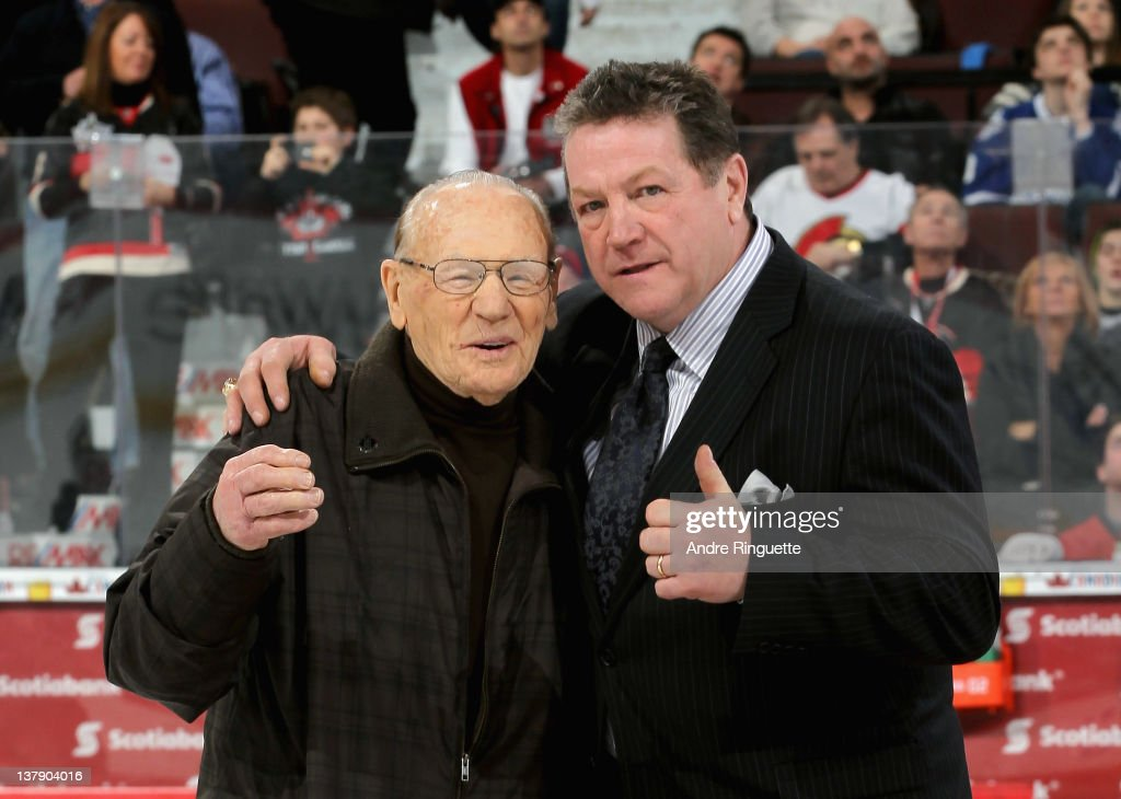 Alumni Johnny Bower and Denis Potvin pose on the ice during the first intermission at the 2012 Tim Hortons NHL All-Star Game at Scotiabank Place on January 29, 2012 in Ottawa, Ontario, Canada.
