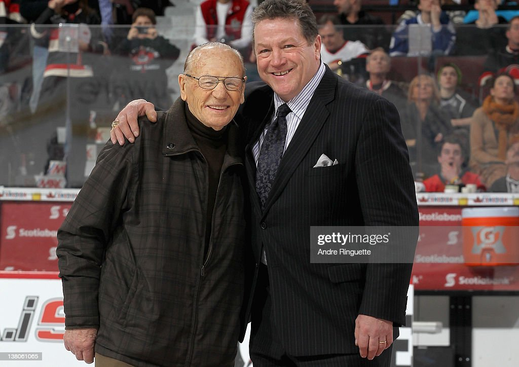 Alumni Johnny Bower (L) and Denis Potvin (R) pose on the ice during the first intermission at the 2012 Tim Hortons NHL All-Star Game at Scotiabank Place on January 29, 2012 in Ottawa, Ontario, Canada.