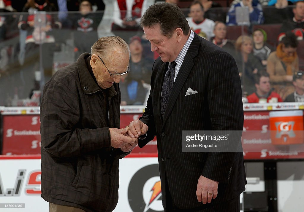 Alumni Johnny Bower and Denis Potvin talk during the first intermission at the 2012 Tim Hortons NHL All-Star Game at Scotiabank Place on January 29, 2012 in Ottawa, Ontario, Canada.