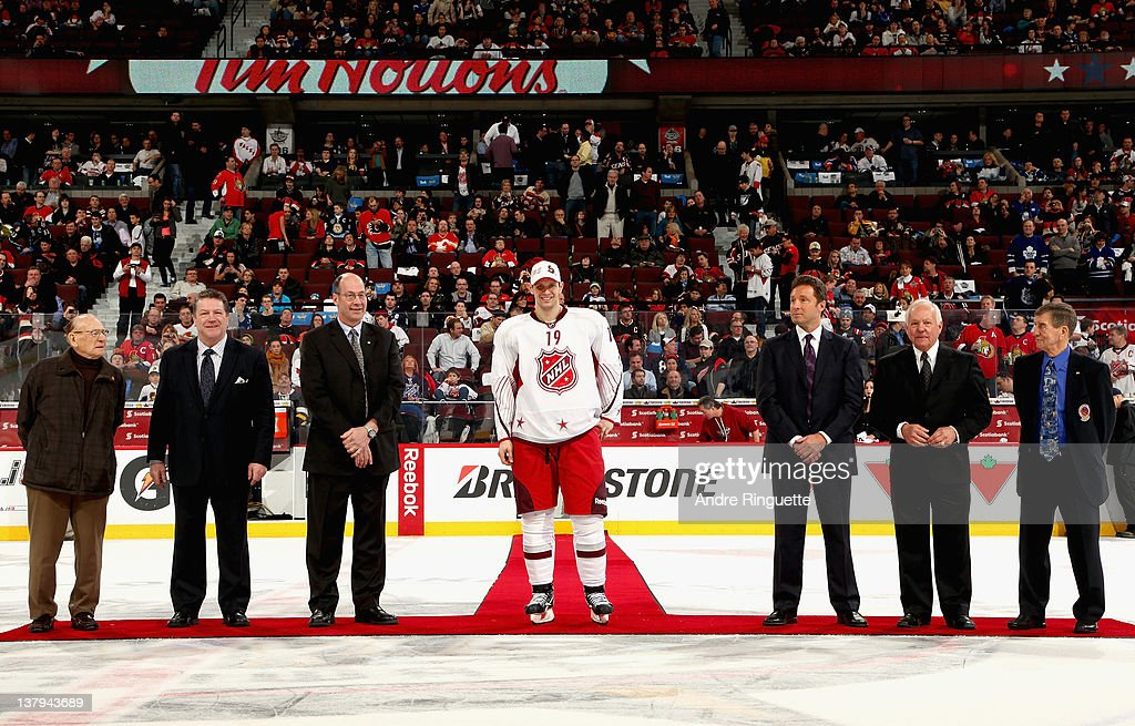 NHL Alumni Johnny Bower, Denis Potvin, Brad Marsh, Jason Spezza #19 of the Ottawa Senators and team Alfredsson, Doug Wilson, Yvan Cournoyer and Ted Lindsay stand on the ice for a presentation during the first intermission at the 2012 Tim Hortons NHL All-Star Game at Scotiabank Place on January 29, 2012 in Ottawa, Ontario, Canada.
