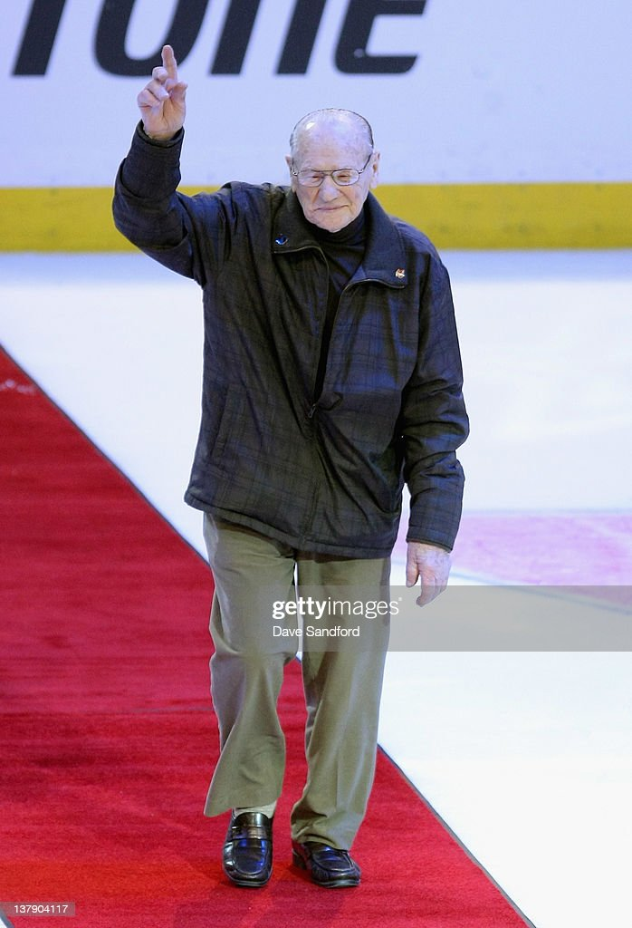Alumni Johnny Bower waves to the crowd during the first intermission at the 2012 Tim Hortons NHL All-Star Game at Scotiabank Place on January 29, 2012 in Ottawa, Ontario, Canada.