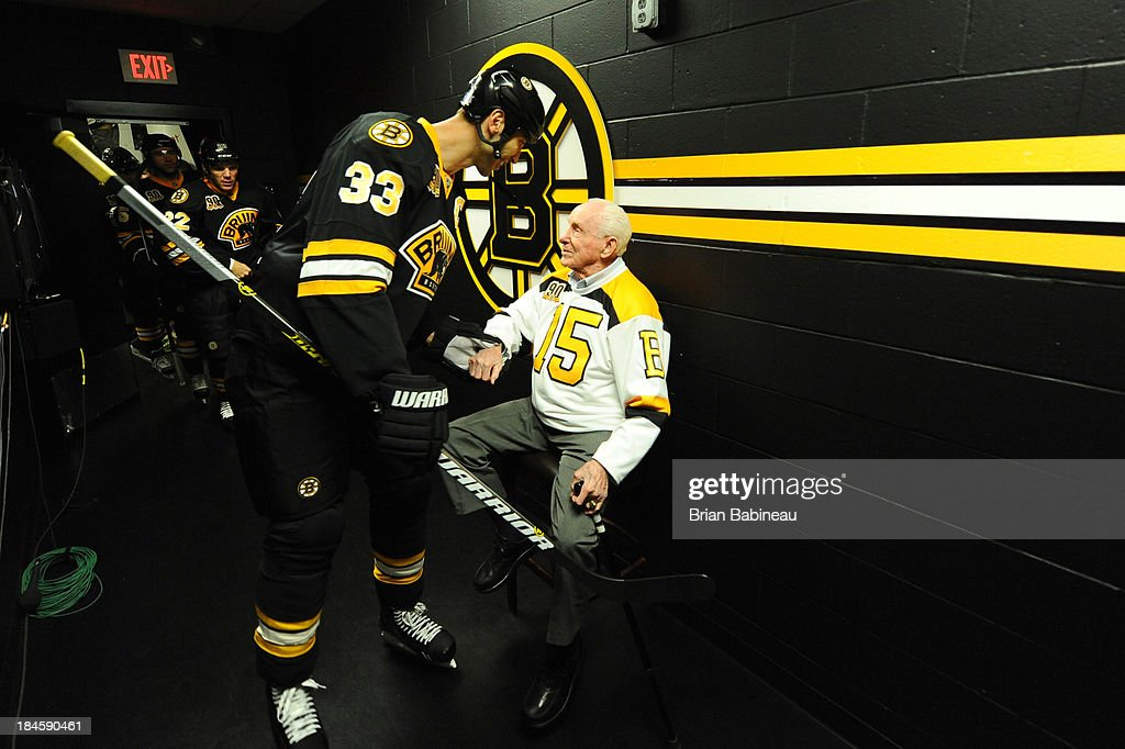 Alumni legend Milt Schmidt and <a gi-track='captionPersonalityLinkClicked' href=/galleries/search?phrase=Zdeno+Chara&family=editorial&specificpeople=203177 ng-click='$event.stopPropagation()'>Zdeno Chara</a> #33 of the Boston Bruins shake hands before the game against the Detroit Red Wings at the TD Garden on October 14, 2013 in Boston, Massachusetts.