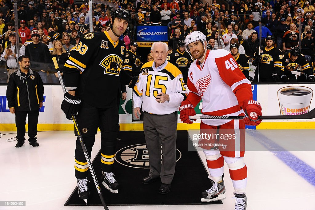 Alumni legend Milt Schmidt poses with <a gi-track='captionPersonalityLinkClicked' href=/galleries/search?phrase=Zdeno+Chara&family=editorial&specificpeople=203177 ng-click='$event.stopPropagation()'>Zdeno Chara</a> #33 of the Boston Bruins and Henrik Zetterberk #40 of the Detroit Red Wings at the TD Garden on October 14, 2013 in Boston, Massachusetts.