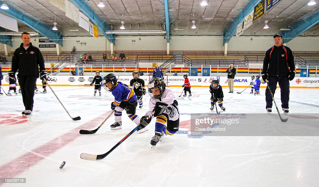 Alumni Mike Gaul and Tom Fergus keep a watch on kids taking part in a hockey clinic held at the Stirling and District Recreation Centre during Kraft Hockeyville Day 2 on October 1, 2012 in Stirling, Ontario, Canada.