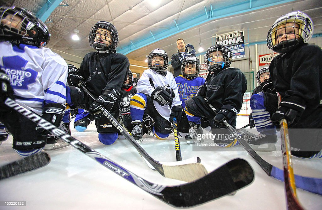 Alumni Mike Gaul (background) listens to instruction as he looks on with the players taking part in a hockey clinic held at the Stirling and District Recreation Centre during Kraft Hockeyville Day 2 on October 1, 2012 in Stirling, Ontario, Canada.