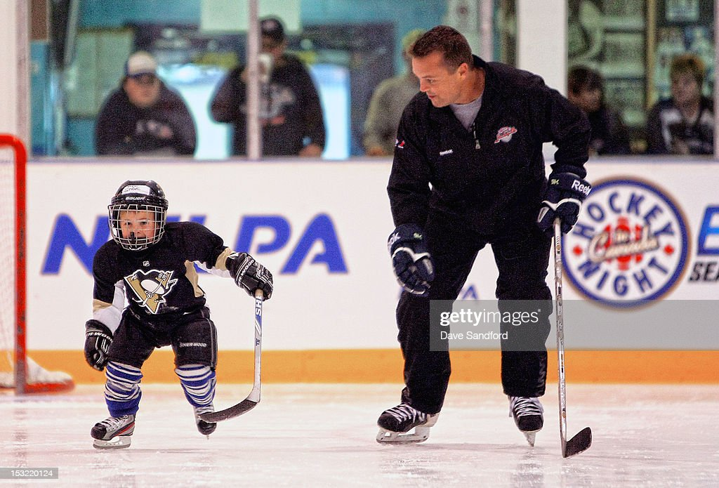 Alumni Mike Gaul teaches kids in a hockey clinic held at the Stirling and District Recreation Centre during Kraft Hockeyville Day 2 on October 2, 2012 in Stirling, Ontario, Canada.