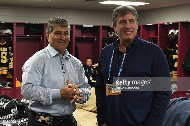 Alumni Ray Bourque and President Cam Neely of the Boston Bruins before the alumni game on December 31 2015 during 2016 Bridgestone NHL Winter Classic...