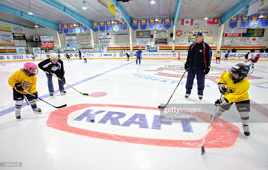 AlumniTom Fergus keeps a watch on pair of girls doing a drill as they take part in a hockey clinic held at the Stirling and District Recreation Centre during Kraft Hockeyville Day 2 on October 1, 2012 in Stirling, Ontario, Canada.
