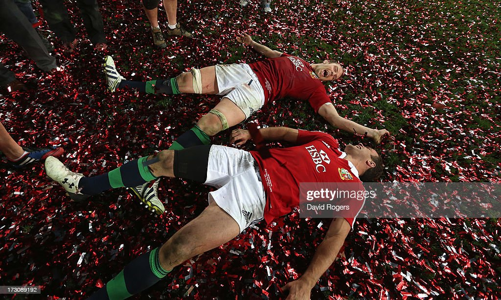 Alun Wyn Jones and <a gi-track='captionPersonalityLinkClicked' href=/galleries/search?phrase=Jamie+Roberts&family=editorial&specificpeople=3530992 ng-click='$event.stopPropagation()'>Jamie Roberts</a> of the Lions roll around in the confetti after their victory during the International Test match between the Australian Wallabies and British & Irish Lions at ANZ Stadium on July 6, 2013 in Sydney, Australia.