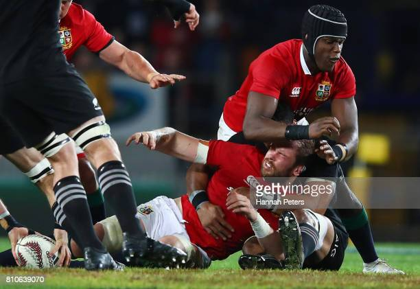 Alun Wyn Jones of the Lions is felled by a high tackle from Jerome Kaino of the All Blacks during the third test match between the New Zealand All...