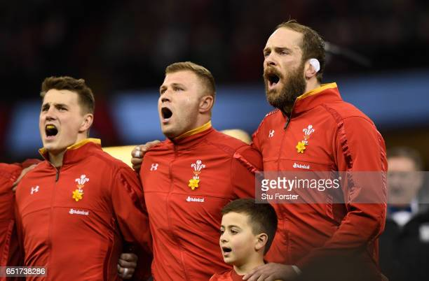 Alun WynJone Ross Moriarty and Jonathan Davies of Wales sing the national anthem prior to kickoff during the Six Nations match between Wales and...