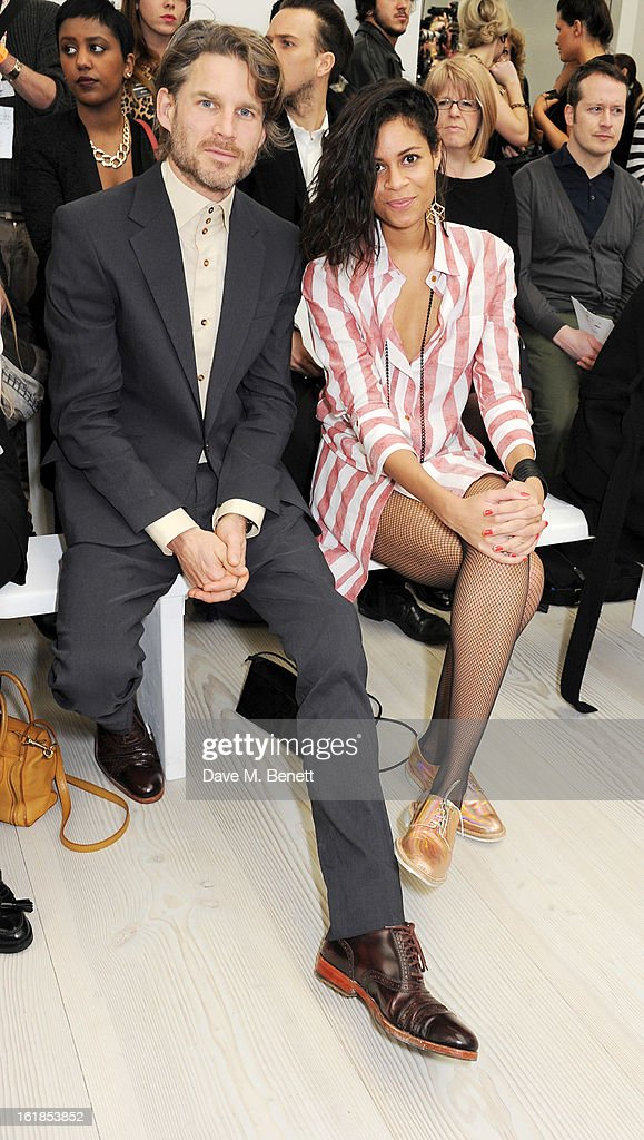 Aluna Francis (R) attends the Vivienne Westwood Red Label show during London Fashion Week Fall/Winter 2013/14 at the Saatchi Gallery on February 17, 2013 in London, England.