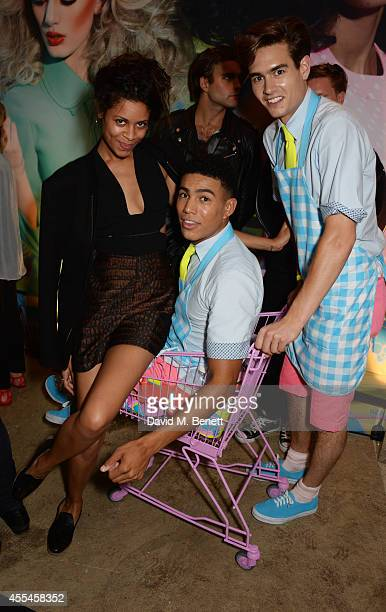 Aluna Francis poses with guests at the MAC x Dazed x Miles Aldridge party at White Rabbit on September 14 2014 in London England
