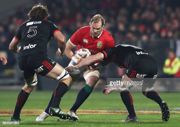 AlunWyn Jones of the Lions is tackled by Sam Whitelock and Heiden BedwellCurtis of the Crusaders during the 2017 British Irish Lions tour match...