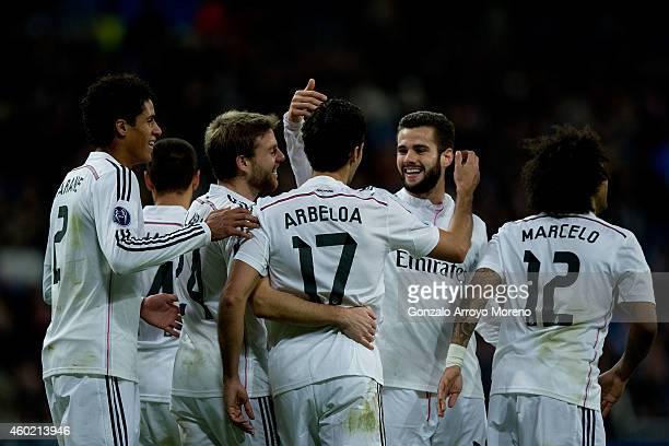 Alvaro Arbeloa celebrates scoring their third goal with teammates Nacho Fernandez Marcelo Raphael Varane Javier Hernandez Chicharito and Asier...