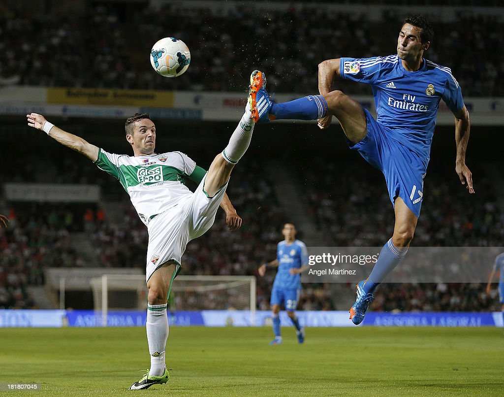 <a gi-track='captionPersonalityLinkClicked' href=/galleries/search?phrase=Alvaro+Arbeloa&family=editorial&specificpeople=3941965 ng-click='$event.stopPropagation()'>Alvaro Arbeloa</a> of Real Madrid competes for the ball with Eduardo Albacar of Elche FC during the La Liga match between Elche FC and Real Madrid at Estadio Manuel Martinez Valero on September 25, 2013 in Elche, Spain.