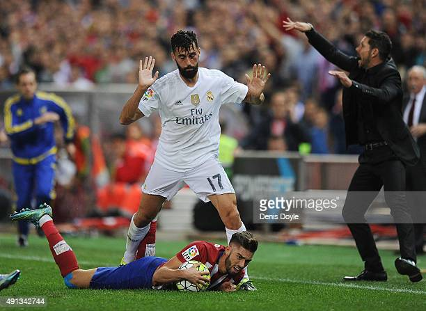 Alvaro Arbeloa of Real Madrid fouls Yannick Carrasco of Club Atletico de Madrid during the La Liga match between Club Atletico de Madrid and Real...