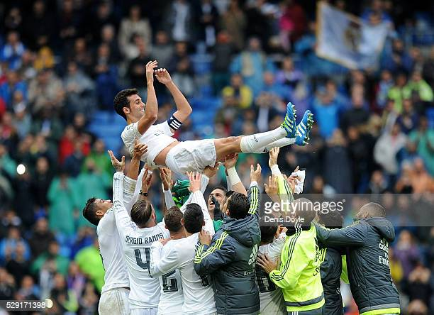 Alvaro Arbeloa of Real Madrid is thrown in the air by his teammates after playing his last match for Real during the La Liga match between Real...