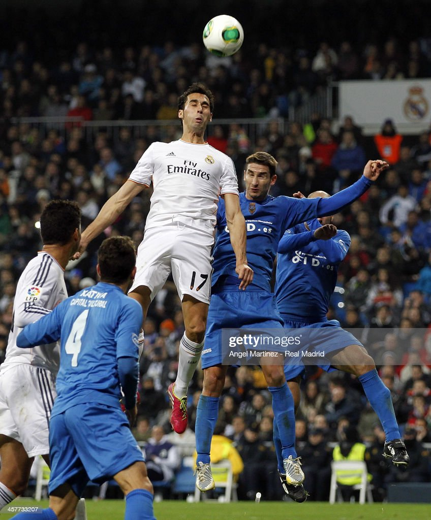 <a gi-track='captionPersonalityLinkClicked' href=/galleries/search?phrase=Alvaro+Arbeloa&family=editorial&specificpeople=3941965 ng-click='$event.stopPropagation()'>Alvaro Arbeloa</a> of Real Madrid jumps for the ball against Samuel Martinez of Olimpic de Xativa during the Copa del Rey, round of 32 match between Real Madrid and Olimpic de Xativa at Estadio Santiago Bernabeu on December 18, 2013 in Madrid, Spain.