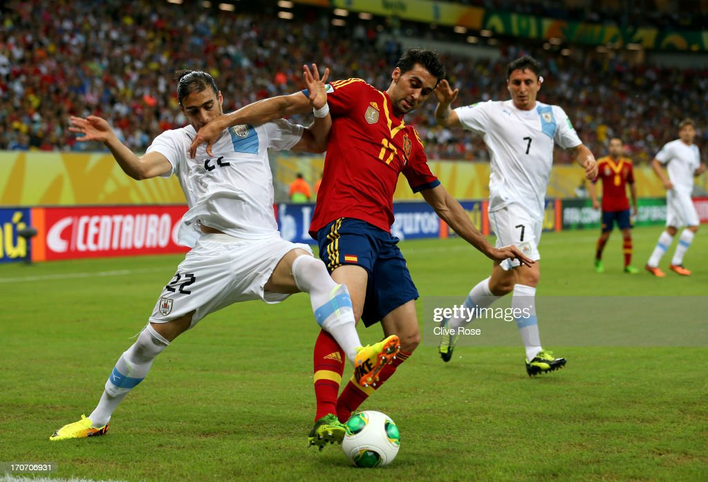 Alvaro Arbeloa of Spain holds off Martin Caceres of Uruguay during the FIFA Confederations Cup Brazil 2013 Group B match between Spain and Uruguay at...